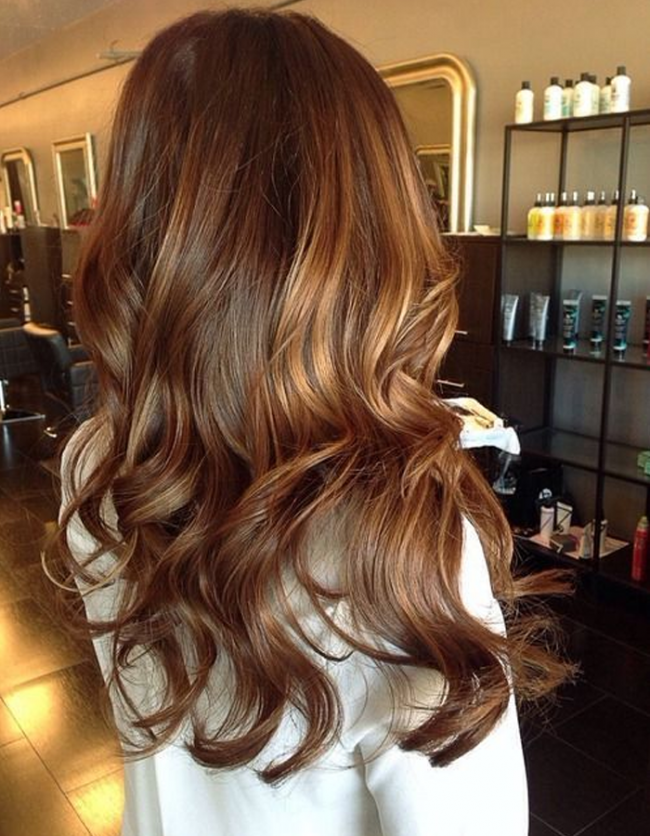 Golden brown hair with caramel highlights
